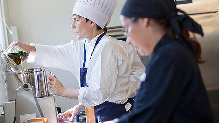 Two chefs preparing food in a kitchen | Interreg Baltic Sea Region